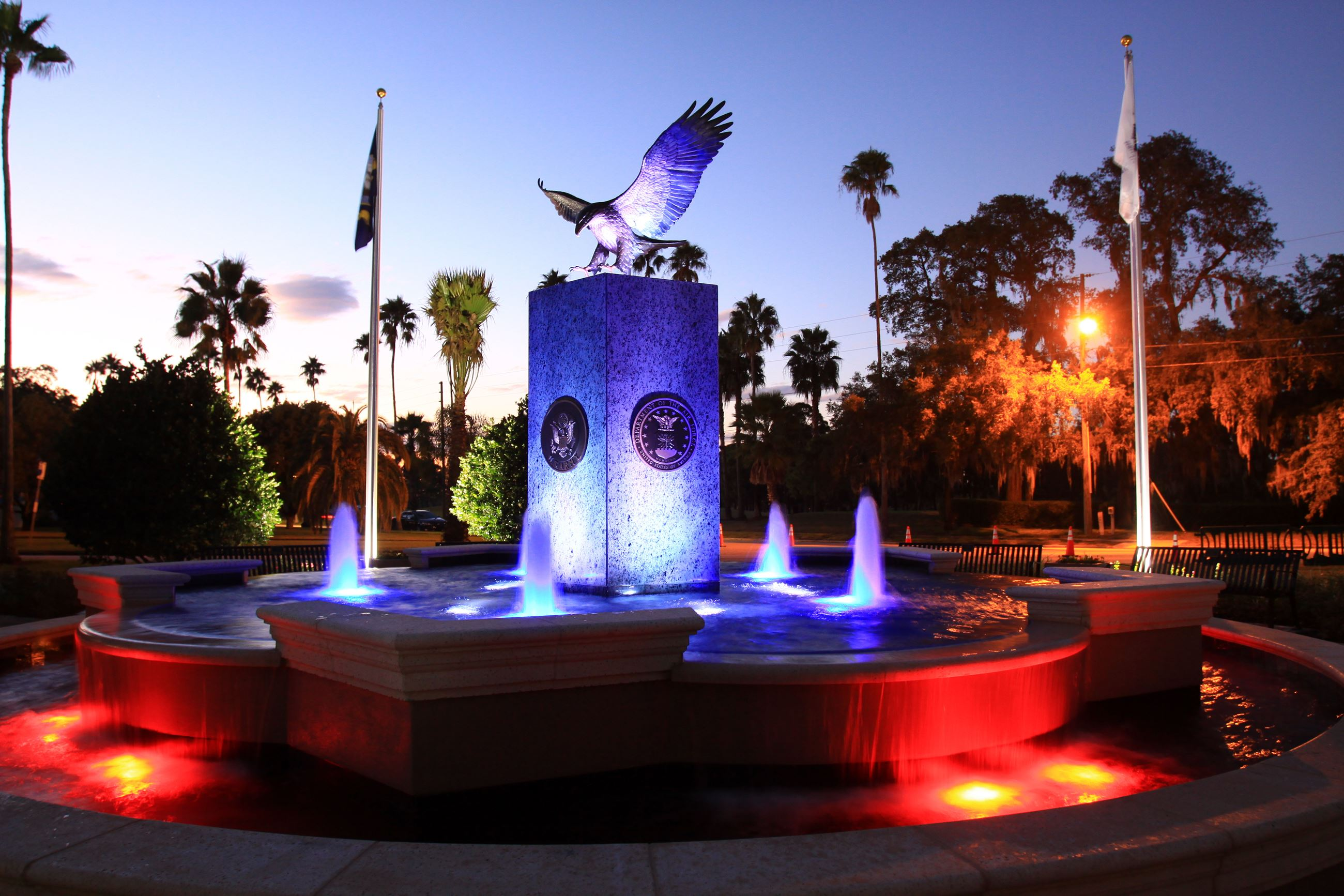The fountain at Hunter Memorial Park at night with red, white, and blue colors