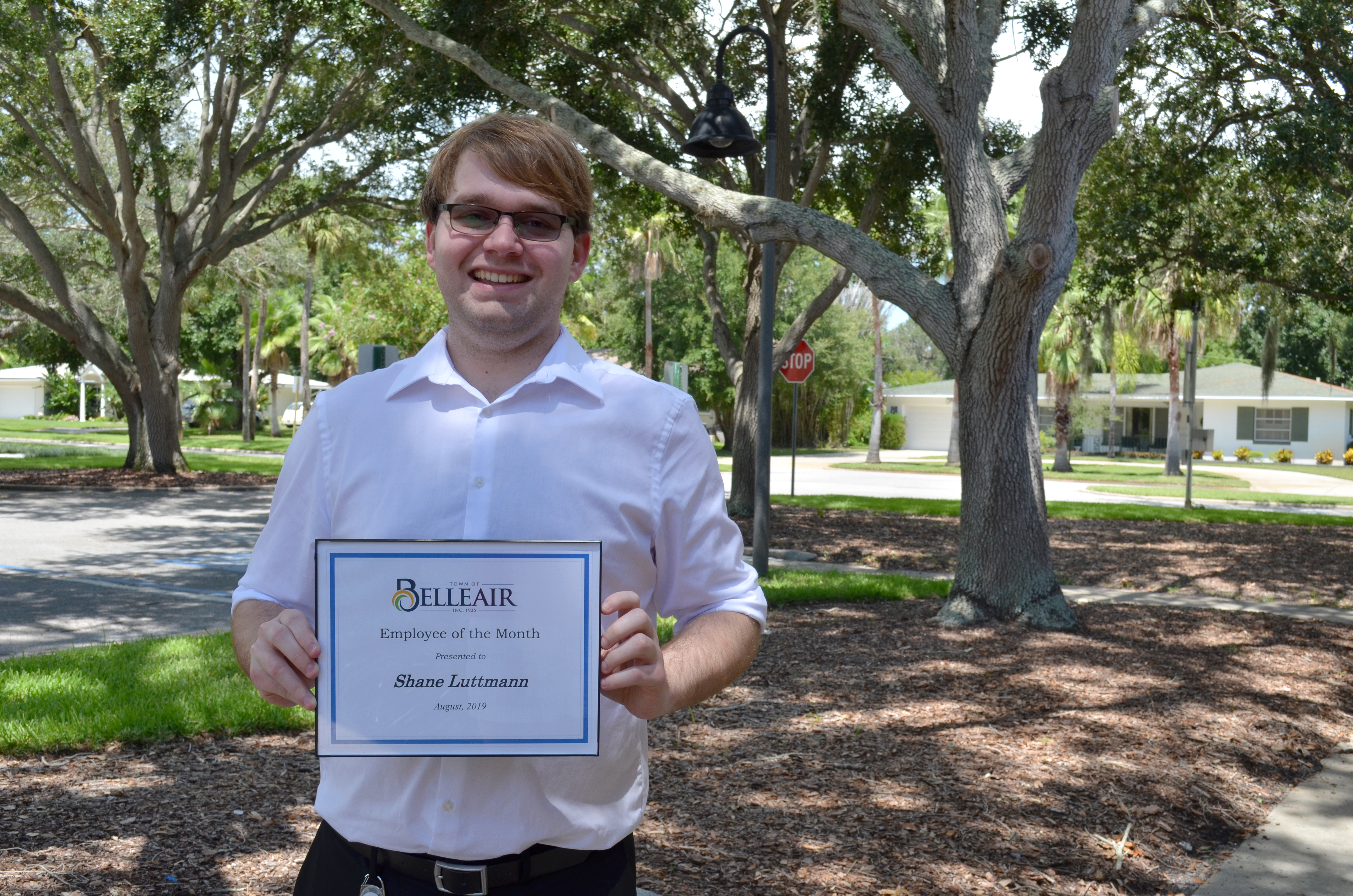 Shane, Belleair&#39s employee of the month, proudly holds his certificate outside of Town Hall, unde