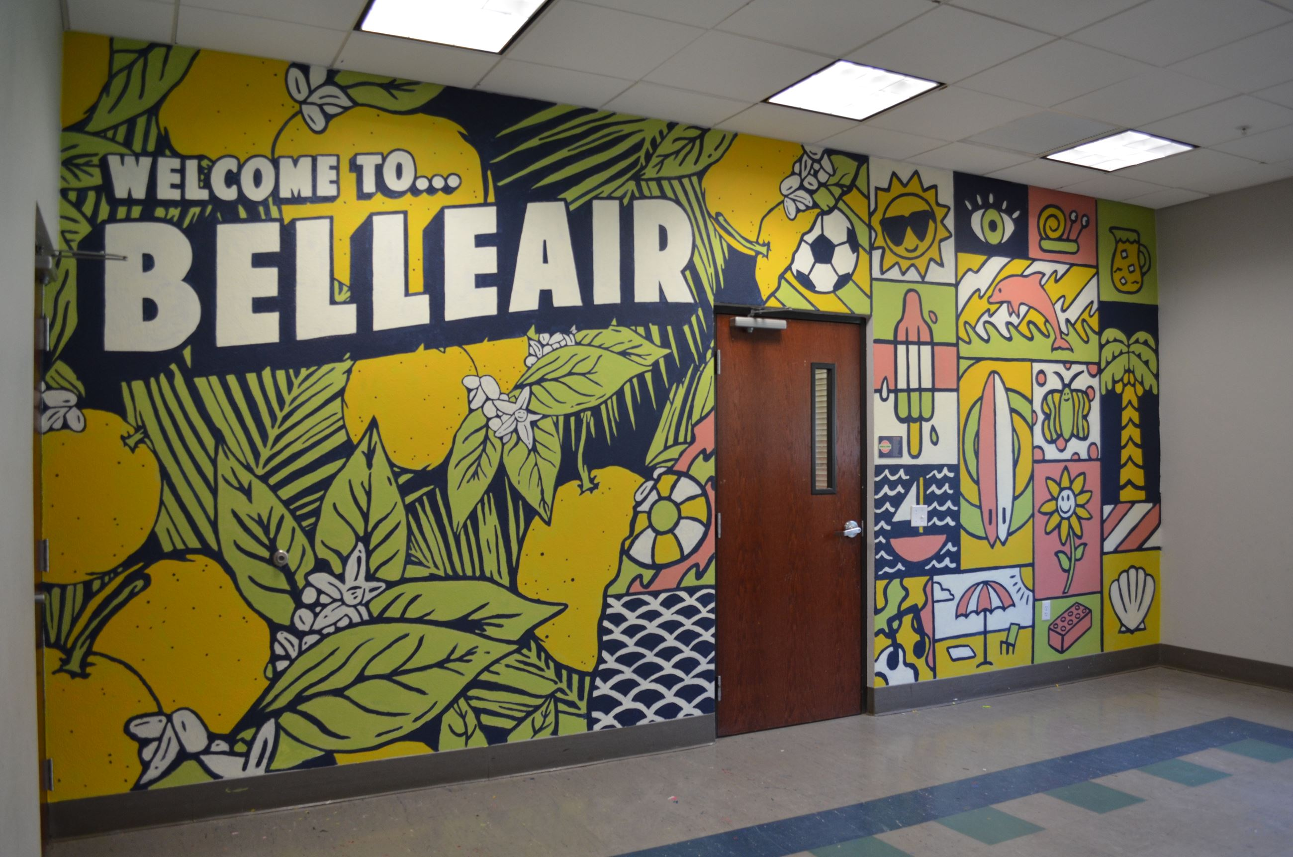 Welcome to Belleair mural wall with colorful oranges and flowers.