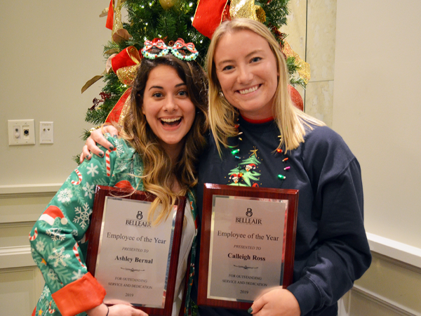 Ashley (left) and Calleigh (right) pose with their matching employee of the year plaques at the Bell