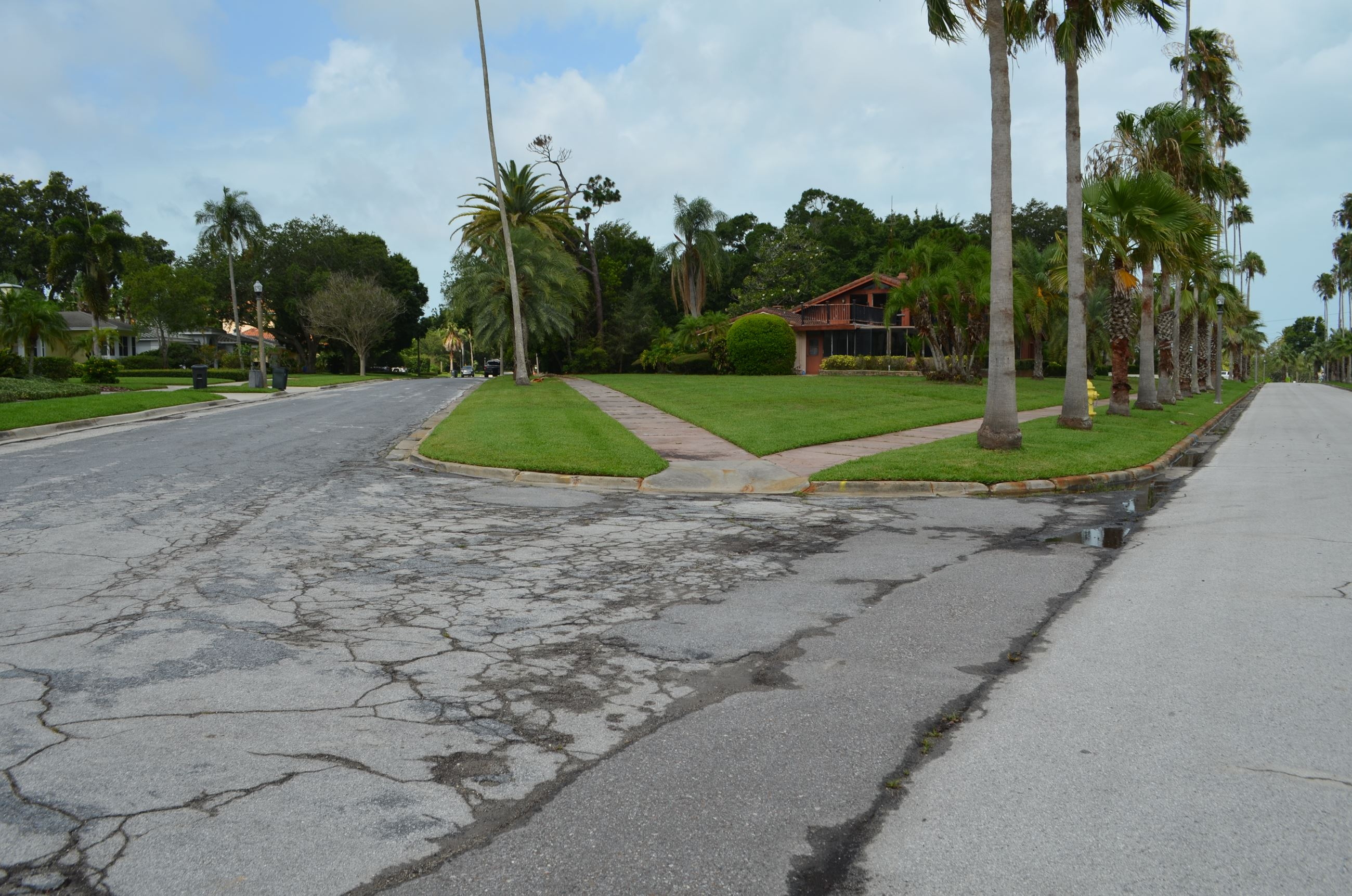 A view of Palmetto Road from Bayview Drive facing east shows the poor condition of the roadway