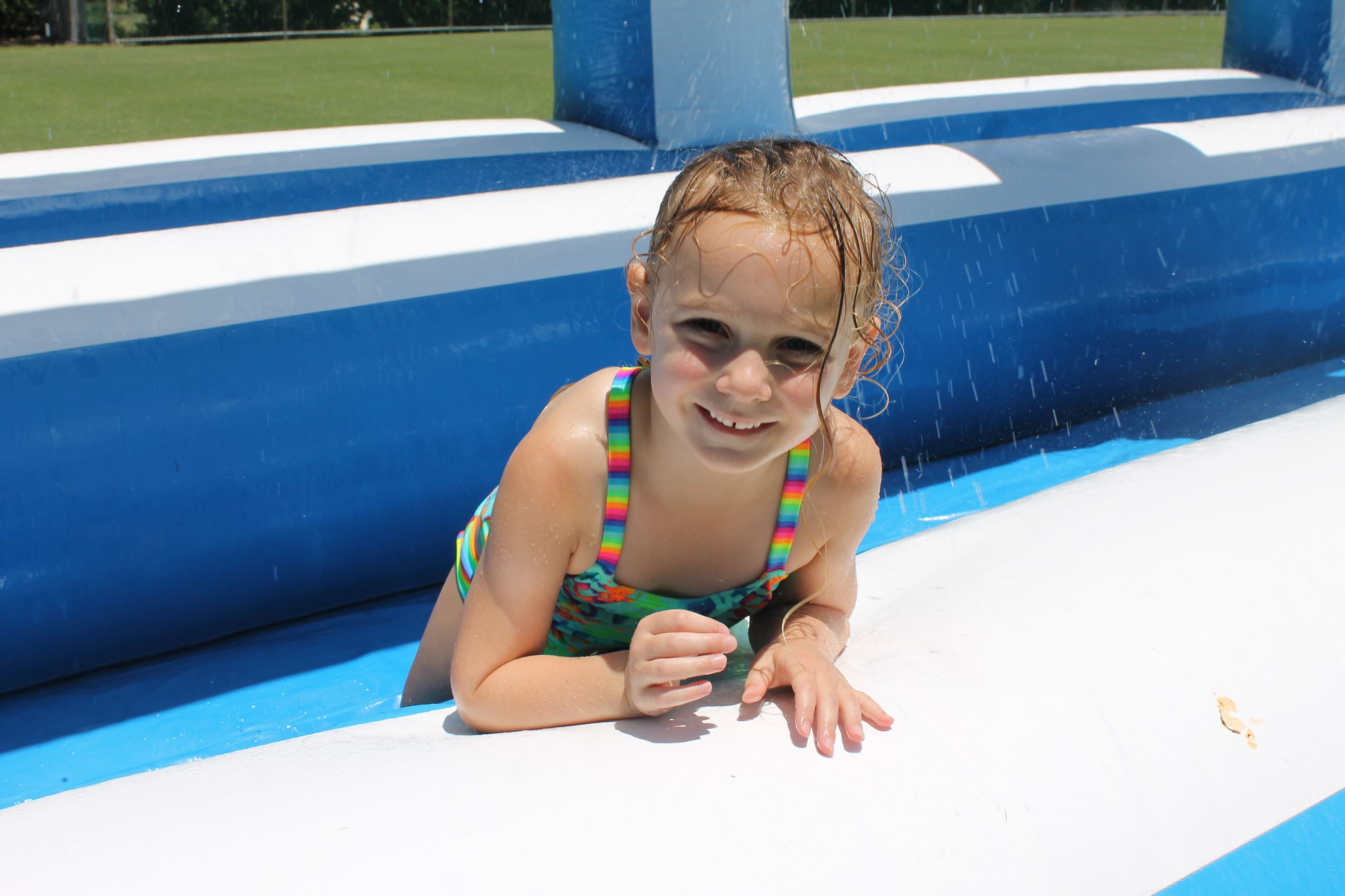 Girl smiles while on a water slide