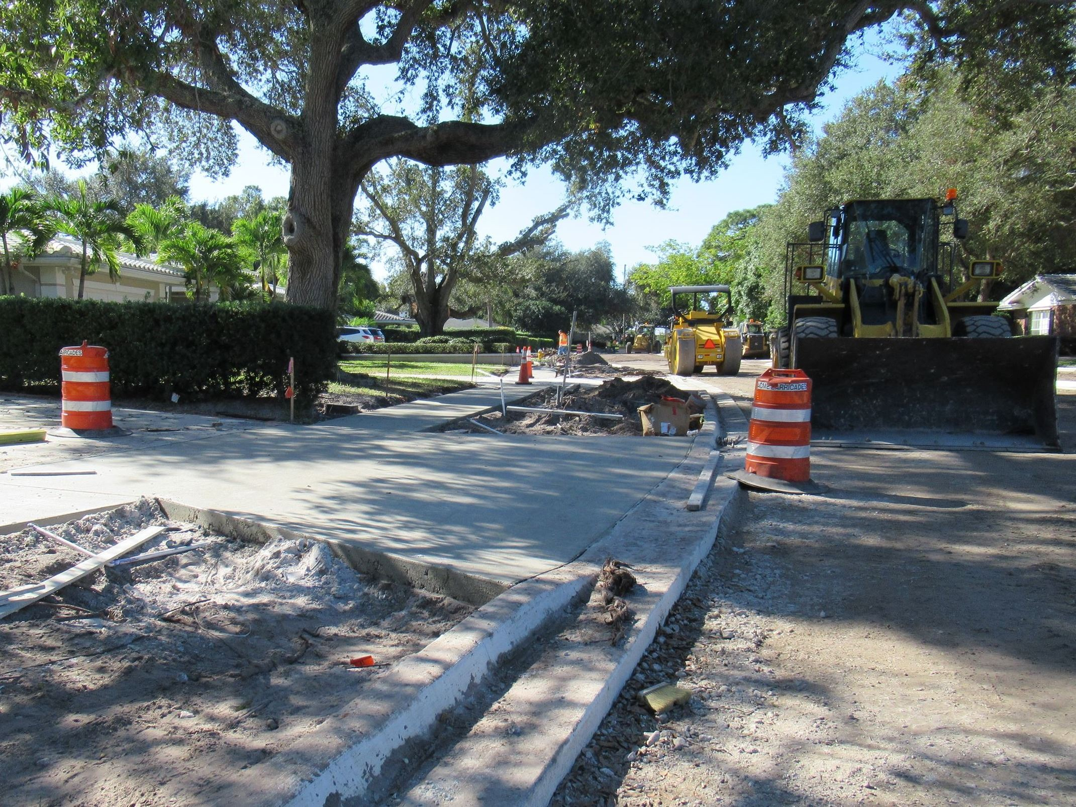 New curb, sidewalk, and driveway has been poured outside of a property on Palmetto Road