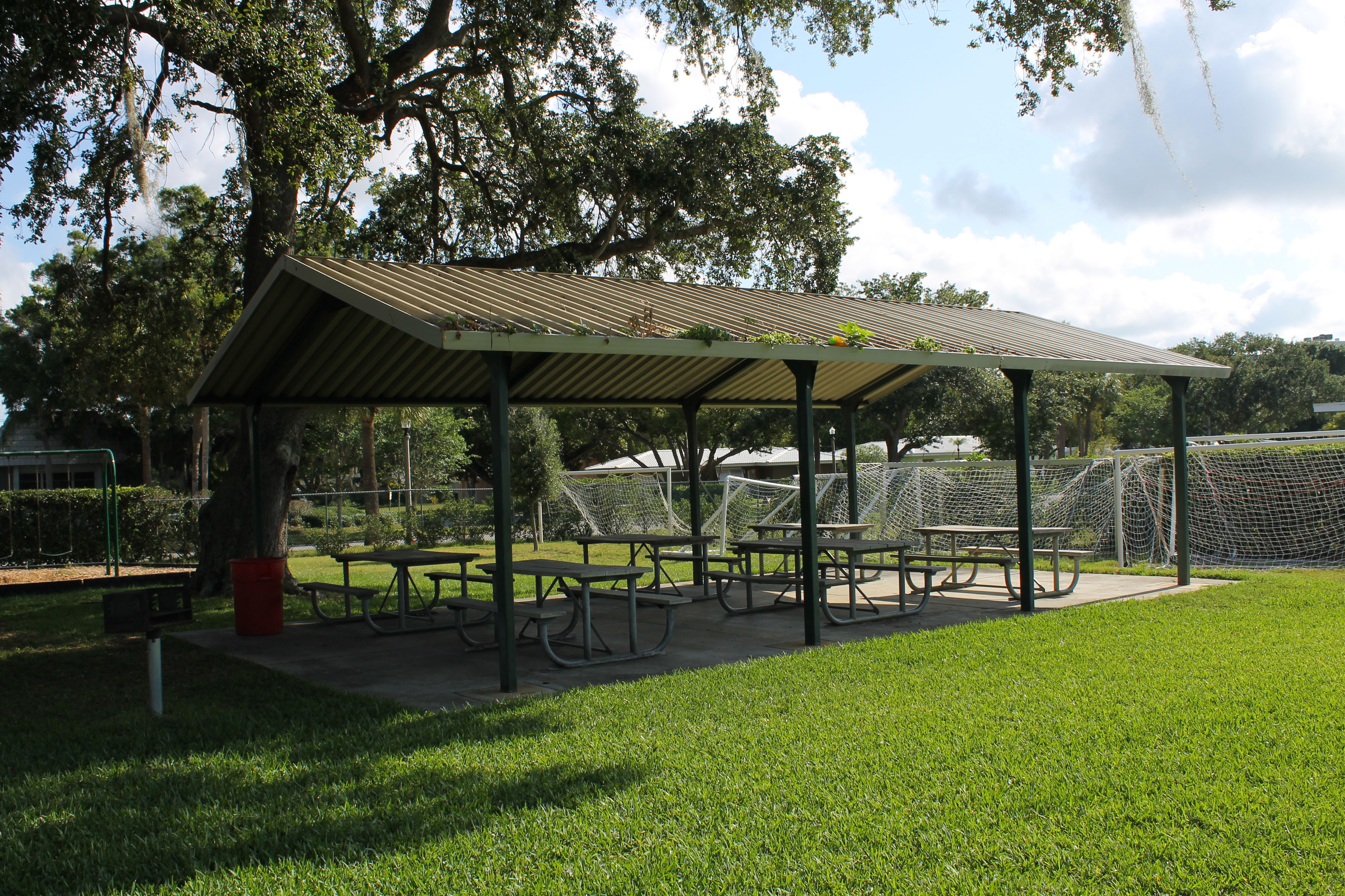 Covered pavilion with benches beneath it on the east athletic field in Belleair