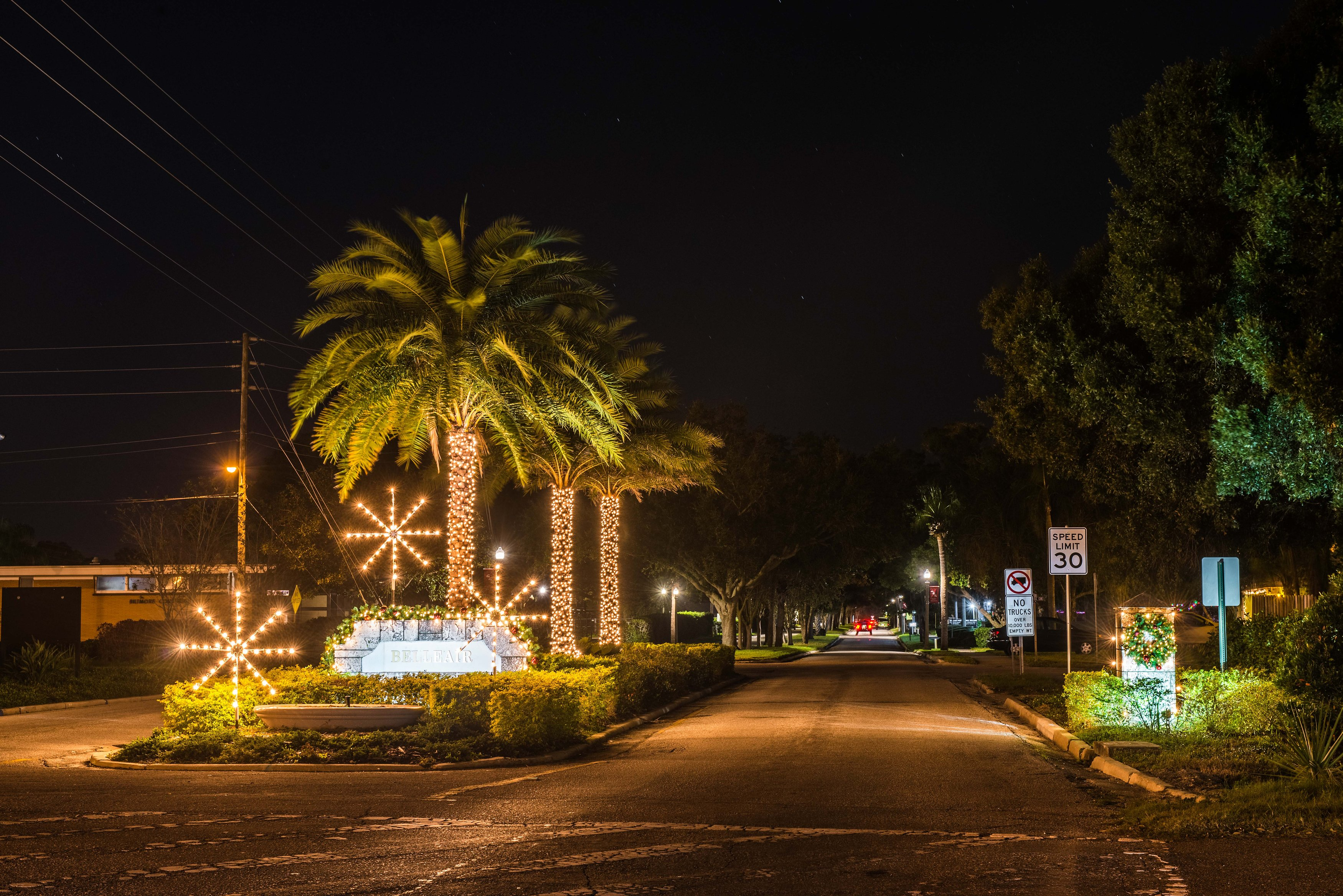 Holiday lighting on trees and in the median of Ponce de Leon Blvd next to the Belleair entrance sign