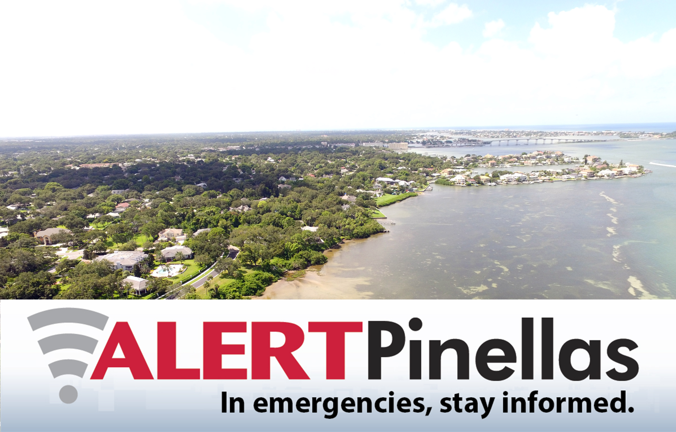 An aerial view of Belleair with text underneath that reads &#34Alert Pinellas: In emergencies, stay