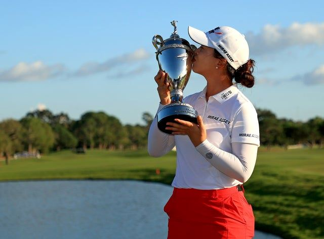 Tournament winner Sei Young Kim kisses her first place trophy at the Pelican Women's Championship